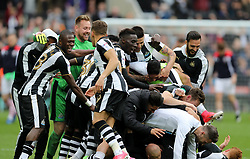 Newcastle United players celebrate winning the Sky Bet Championship during the Sky Bet Championship match at St James' Park, Newcastle.