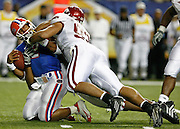 Florida QB Chris Leak is tackled by Arkansas DE Marcus Shavers and an unidentified defensive player during the SEC Championship game between the Arkansas Razorbacks and the Florida Gators at the Georgia Dome in Atlanta, GA on December 2, 2006.<br />