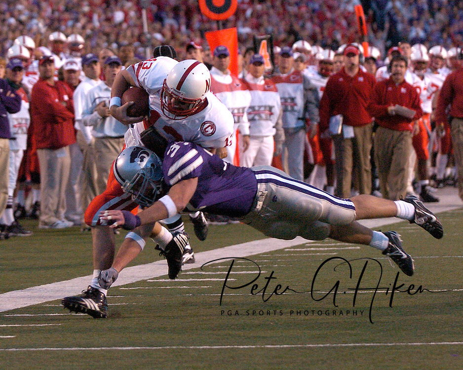 Kansas State linebacker Marcus Perry (37) knocks Nebraska quarterback Zac Taylor (13) out of bounds, after picking up a first down at Bill Snyder Family Stadium in Manhattan, Kansas, October 14, 2006.  The Huskers beat the Wildcats 21-3.<br />