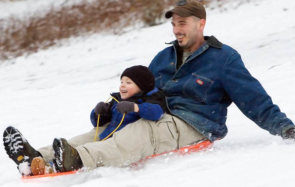 NAUGATUCK, CT- 14 JAN 2008- 011408JT07-.Anthony Verzino, of Waterbury, and his son Brenden, 4, sled down a hill at Hop Brook Golf Course in Naugatuck on Monday after a snow storm dropped several inches of snow in the area. .Josalee Thrift / Republican-American