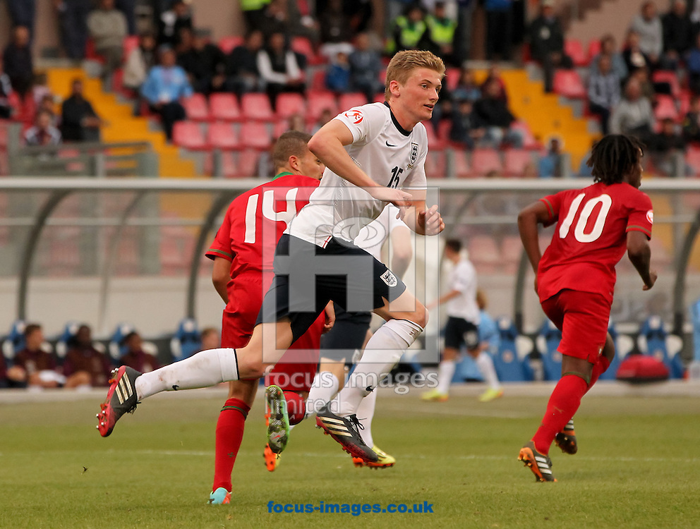 Taylor Moore (centre) of England during the 2014 UEFA European Under-17 match at Ta' Qali National Stadium, Attard<br /> Picture by Tom Smith/Focus Images Ltd 07545141164<br /> 18/05/2014