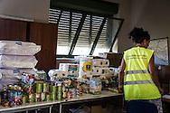 Roma, Italia, 25/08/2016<br /> Uno dei centri attivati a Roma per la raccolta di viveri e indumenti per gli abitanti di Accumoli e Amatrice, colpiti dal terremoto. Nella foto il centro di raccolta del XI Municipio, in via della Magliana.<br /> <br /> Rome, Italy, 25/08/2016<br /> One of the active centers in Rome to collect food and clothing for the people of Accumoli and Amatrice hit by the earthquake. In the picture the center of XI Municipality in Magliana road.