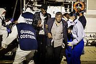 ITALY, Augusta - An immigrant desembarks from an Italian Coast Guard in the port of Augusta (Sicily) on June 16, 2014. A new immigration wave is investing the italian region of Sicily.<br /> <br /> Augusta, Italia - 16 giugno 2014. Circa 400 immigrati sono stati tratti in salvo da alcune unit&agrave; della Capitaneria di Porto nell'ambito dell'operazione Mare Nostrum. I migranti sono sbarcati nel porto di Augusta in Sicilia. Da circa un mese gli sbarchi si susseguono quotidianamente.<br /> Ph. Roberto Salomone