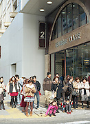People in front of a department store waiting to cross the road on the official 2,672nd anniversary of Japan.