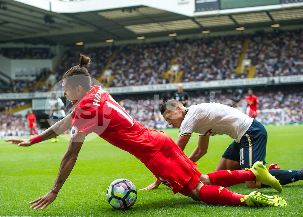 Erik Lamela of Tottenham Hotspur fouls Roberto Firmino of Liverpool in the penalty area during the Premier League match between Tottenham Hotspur and Liverpool at White Hart Lane, London, England on 27 August 2016. Photo by Vince  Mignott.