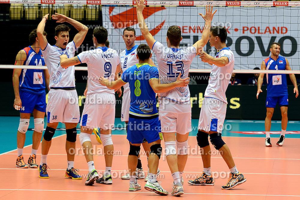 20-09-2013 VOLLEYBAL: EK MANNEN SERVIE - SLOVENIE: HERNING<br /> Vreugde bij Slovenie als zij Servie met 3-1 verslaan<br /> &copy;2013-FotoHoogendoorn.nl<br />  / SPORTIDA