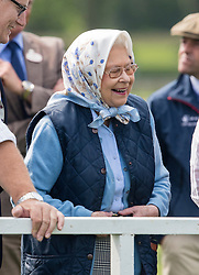 WINDSOR - UK  - 12th May 2016: <br /> The Royal Windsor Horse Show held in Windsor Great Park and Home Park. HM Queen Elizabeth watches her horse  Barbers Shop , No 513 compete and win The Tattersalls and Ror Thoroughbred Ridden Show Horse Championship.<br /> Photograph by  Ian Jones