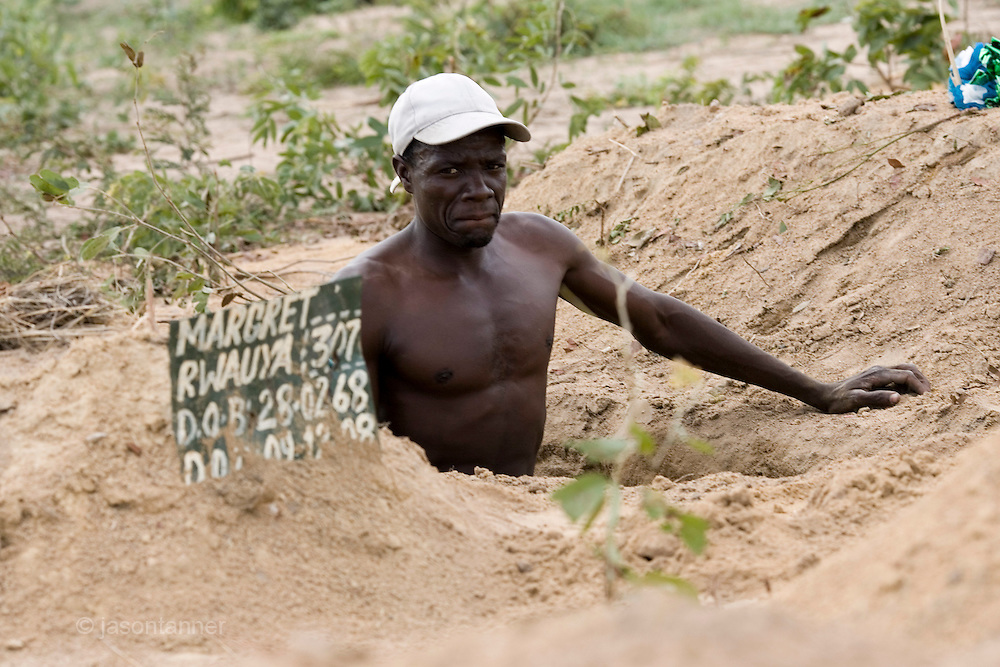 A government cemetery worker prepares the grave of a Cholera victim at a cemetery in the suburb of Budiriro on the outskirts of Harare, Zimbabwe.....