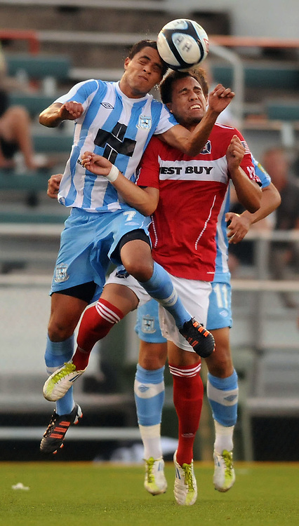 Wilmington Hammerheads Manny Guzman (7) heads the ball away from Cal FC's Derby Rafael Carrillo (6) in the second round of the 2012 U.S. Open Cup at Legion Stadium in Wilmington, N.C. Tuesday, May 22, 2012. Photo by Mike Spencer