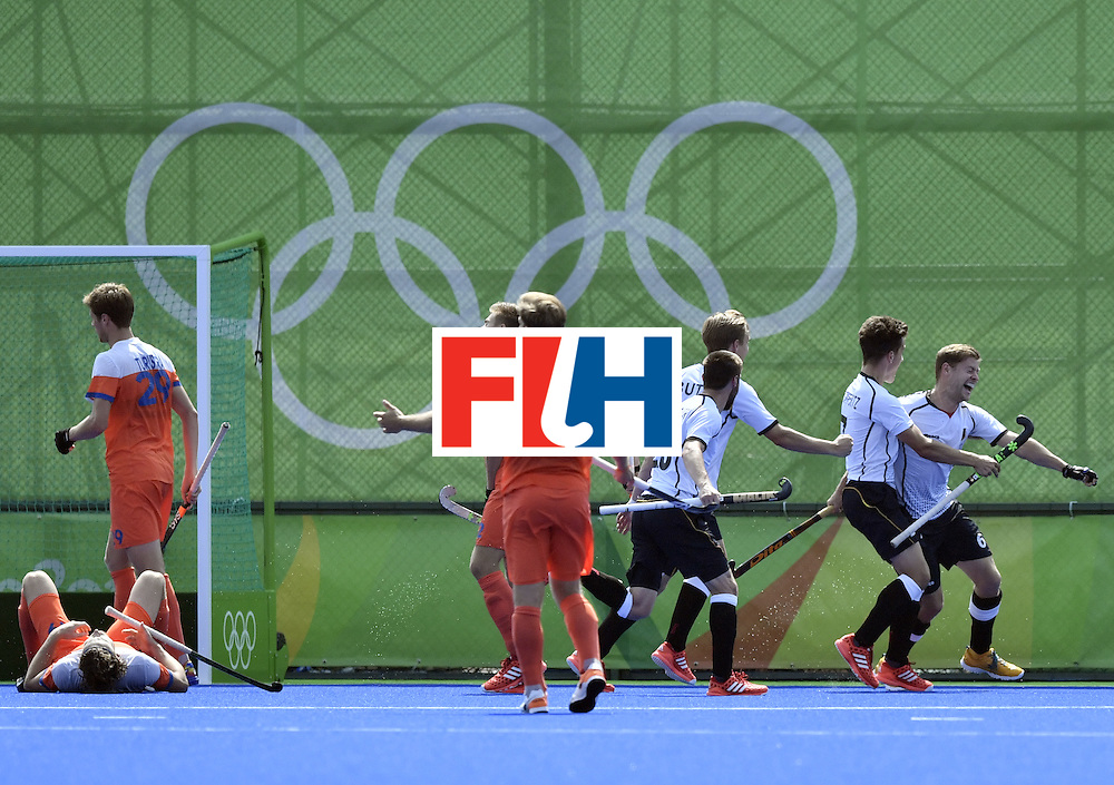 Germany's Martin Haner (R) celebrates a goal with teammates during the men's Bronze medal field hockey Netherlands vs Germany match of the Rio 2016 Olympics Games at the Olympic Hockey Centre in Rio de Janeiro on August 18, 2016. / AFP / PHILIPPE LOPEZ        (Photo credit should read PHILIPPE LOPEZ/AFP/Getty Images)