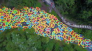 "SANMENXIA, CHINA - AUGUST 16: <br /> <br /> Hundreds of tourists drifting in the gorge<br /> <br /> Aerial view of tourists drifting in the gorge in summer, thus causing congestion on August 16, 2017 in Sanmenxia, Henan Province of China. Chinese ""dama"" got their canoes into the riffle and danced to music to calm down tourists who were waiting anxiously. <br /> ©Exclusivepix Media"