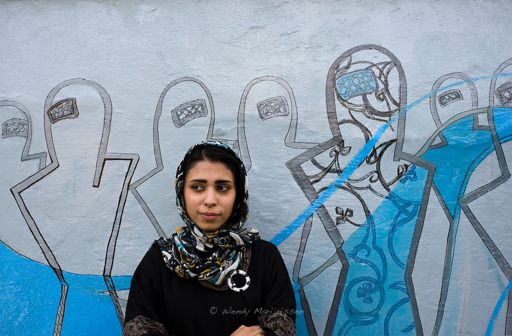 Shamsia Hassani, a young contemporary artist from Afghanistan. She is Afghanistan's first female graffiti artist, a member of the Roshd art collective and sculpture teacher at the Kabul University. The female figures in burqa are a symbol she uses to talk about women's rights and the problems women in her country face. Kabul, Afghanistan, 2012