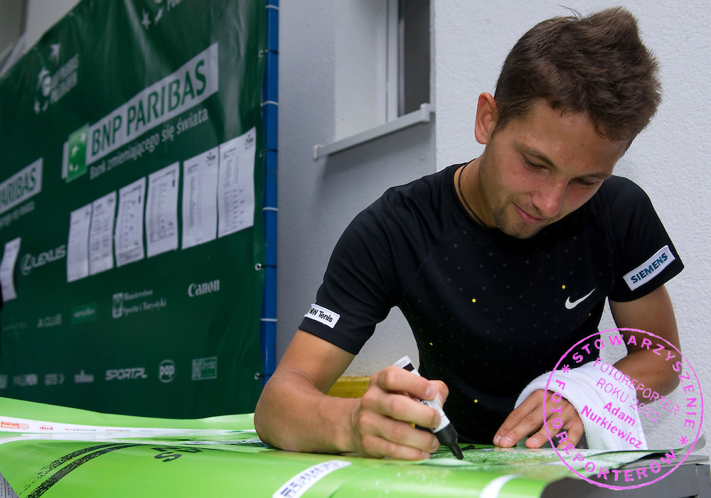 MARCIN GAWRON (POLAND) WHILE AUTOGRAPH SESSION DURING DAY 4 OF THE MEN'S SINGLES TOURNAMENT BNP PARIBAS POLISH OPEN AT TENNIS CLUB IN SOPOT, POLAND...POLAND, SOPOT , JULY 14, 2011..( PHOTO BY ADAM NURKIEWICZ / MEDIASPORT )..PICTURE ALSO AVAIBLE IN RAW OR TIFF FORMAT ON SPECIAL REQUEST.