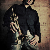 A young man holding a trumpet