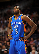 Feb. 4, 2011; Phoenix, AZ, USA; Oklahoma City Thunder forward Serge Ibaka (9) reacts on the court against the Phoenix Suns at the US Airways Center. The Thunder defeated the Suns 111-107. Mandatory Credit: Jennifer Stewart-US PRESSWIRE
