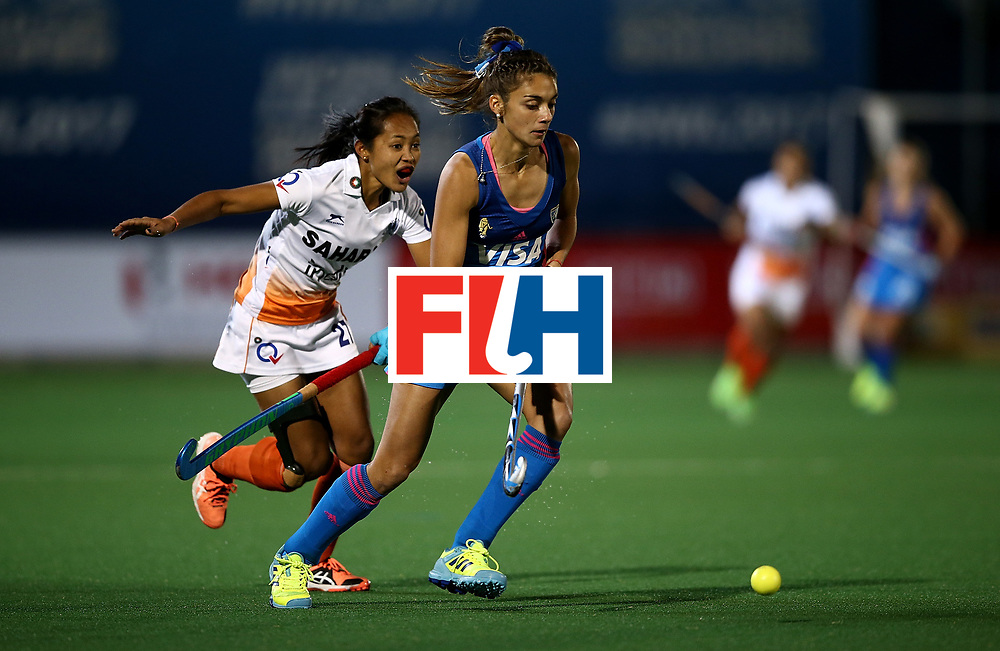 JOHANNESBURG, SOUTH AFRICA - JULY 16:  Magdalena Fernandez of Argentina controls the ball from Sushila Pukhrambam of India during day 5 of the FIH Hockey World League Women's Semi Finals Pool B match between Argentina and India at Wits University on July 16, 2017 in Johannesburg, South Africa.  (Photo by Jan Kruger/Getty Images for FIH)