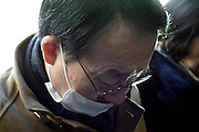 portrait of Asian senior male person wearing mask during train commute Tokyo Japan