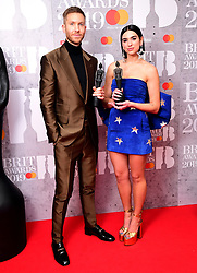 Dua Lipa and Calvin Harris with their Best British Single Brit Award in the press room at the Brit Awards 2019 at the O2 Arena, London.