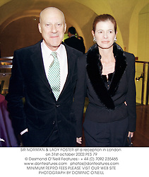 SIR NORMAN & LADY FOSTER at a reception in London on 31st october 2002.PES 79