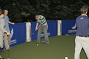 ANDY DUNDERDALE, Alfred Dunhill Million Dollar Putt, the Dunhill Clubhouse. Broadgate Arena.London EC2. 25 July 2006.  ONE TIME USE ONLY - DO NOT ARCHIVE  © Copyright Photograph by Dafydd Jones 66 Stockwell Park Rd. London SW9 0DA Tel 020 7733 0108 www.dafjones.com