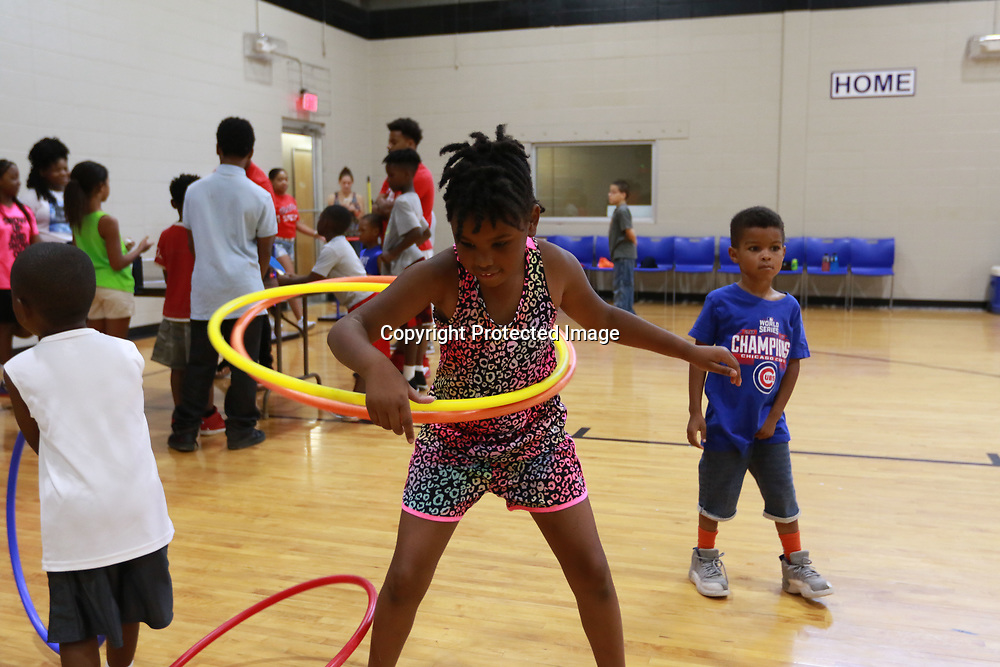 LIBBY EZELL | BUY AT PHOTOS.DJOURNAL.COM<br /> Aniyah Johnson, 7, uses two hula hoops Saturday at the Police and kids fun day