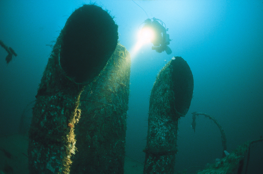 A diver and the cowls of D/S Nesodtangen . This wreck lies on 48 metres of water just outside Stavanger city. Location: Norway