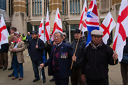 Whitehall, London, April 4th 2015. As PEGIDA UK holds a poorly attended rally on Whitehall, scores of police are called in to contain counter protesters from various London anti-fascist movements. PICTURED: A small group of retired Gurkhas lend their support to the PEGIDA rally.