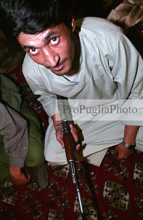 A servant holding an AK-47 at the Kandahar's Governor house