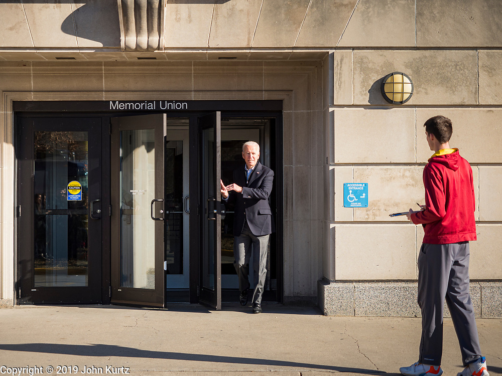 """04 DECEMBER 2019 - AMES, IOWA: Former Vice President JOE BIDEN leaves the Memorial Union at Iowa State University after his campaign event in Ames Wednesday. Vice President Biden is touring Iowa this week on his """"No Malarkey"""" bus tour. Iowa hosts the first presidential selection event of the 2020 election cycle. The Iowa caucuses are on February 3, 2020.        PHOTO BY JACK KURTZ"""