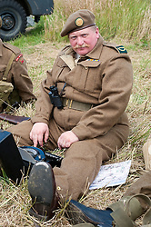 A reenactor portrays a uniformed war correspondent with portable Typewriter at the Spam Wartime Weekend Heckmondwike<br />