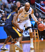 SAN DIEGO, CA - MARCH 16:  West Virginia Mountaineers guard Jevon Carter (2) drives against Murray State Racers guard Jonathan Stark (2) during a first round game of the Men's NCAA Basketball Tournament at Viejas Arena in San Diego, California. West Virginia won 85-68.  (Photo by Sam Wasson)
