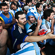 Argentinean fans react to a call on a German player in the final match of the World Cup on Copacabana Beach in Rio de Janeiro on Sunday, July 13, 2014. Credit: Byron Smith