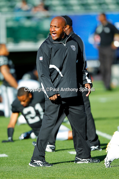 Oakland Raiders Offensive Coordinator Hue Jackson calls out during pregame warmups during the NFL preseason week 3 football game against the San Francisco 49ers on Saturday, August 28, 2010 in Oakland, California. The 49ers won the game 28-24. (©Paul Anthony Spinelli)