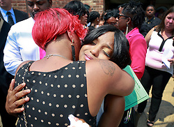 07 September 2013. New Hope Baptist Church. New Orleans, Louisiana. <br /> Andrea Samuels (mother of victim - 22 yrs old) ) at the funeral service for her daughter, 1 year old toddler Londyn Unique Reed Samuels, shot to death August 29th.  The infant Londyn was shot by thugs whilst in the arms of her babysitter, the intended victim who was holding Londyn whilst walking down the street at the time of the assault. NOPD has arrested 2 men in connection with the heinous crime.<br /> Photo; Charlie Varley