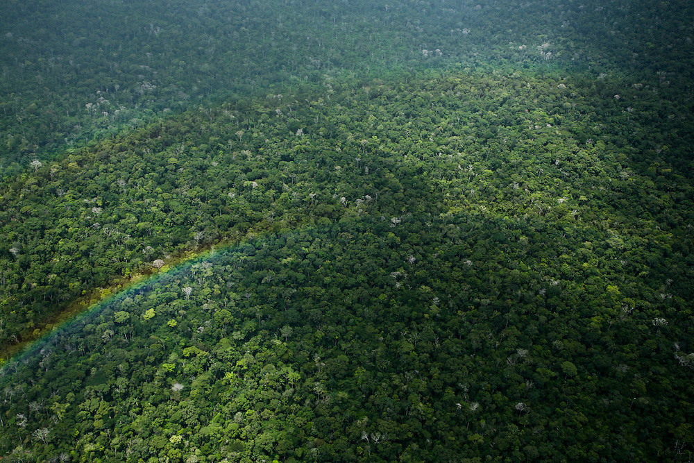 February 23rd 2006. A rainbow over the rainforest somewhere between Alta Floresta and Sinop, Mato Grosso State, Brazil, and the Xingu area....©Daniel Beltra