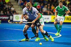 Germany's Niklas Wellen is tackled by Paul Gleghorne of Ireland. Ireland v Germany - Unibet EuroHockey Championships, Lee Valley Hockey & Tennis Centre, London, UK on 23 August 2015. Photo: Simon Parker