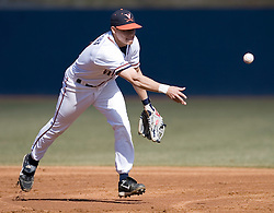 Virginia Cavaliers infielder Greg Miclat (2) tosses to second for a force out against Delaware.  The Virginia Cavaliers Baseball Team defeated the Delaware Blue Hens 10-4  in the second of a three game series at Davenport Field in Charlottesville, VA on March 3, 2007.  Virginia leads the series 2 games to 0.