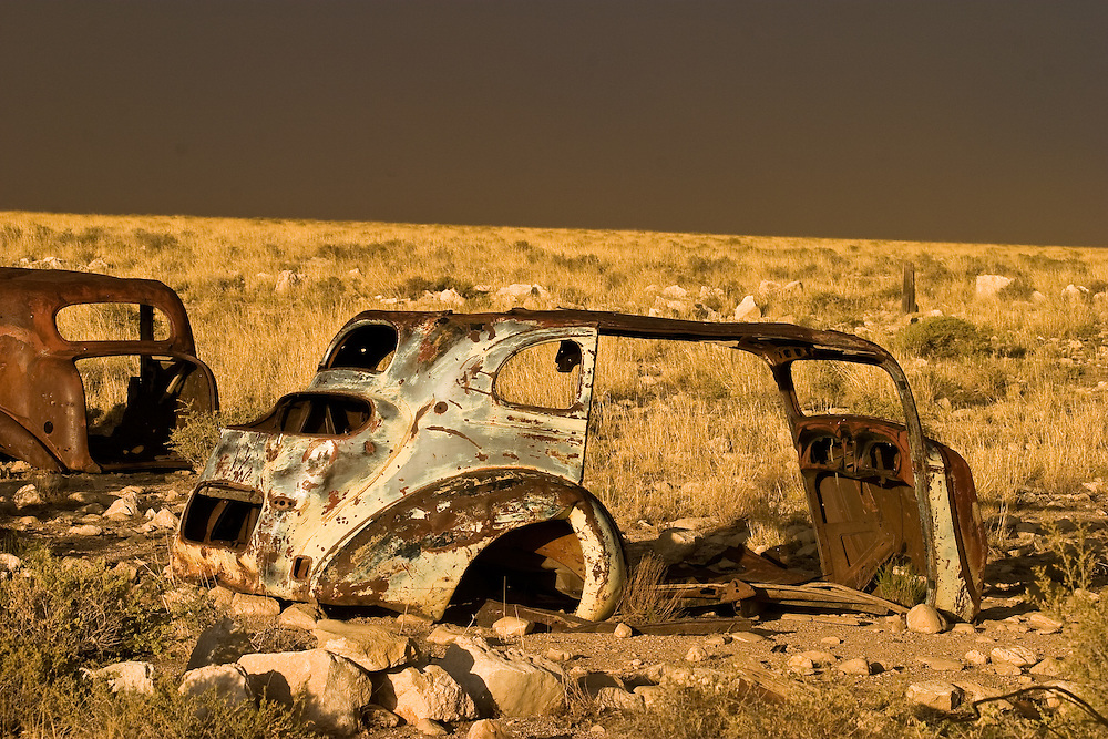 Old cars rusting near Canyon Diablo in Northern Arizona, rain storm approaching