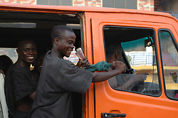 "GHANA,Accra,Kokomlemle, 2007. By far the most common form of public transport in sprawling Accra, ""tro-tros"" operate on fixed routes and charge cheap prices."