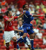 Photo: Rich Eaton.<br /> <br /> Barnsley v Cardiff City. Coca Cola Championship.<br /> <br /> 05/08/2006. Cardiff goalscorer #9 Steve Thompson rises above the Barnsley defence