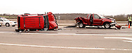 Ohio State Patrol troopers David Griffith (front) and Frank Simmons investigate an accident at the intersection of US 35 and Trebein Road near Xenia, Saturday, March 26, 2011.