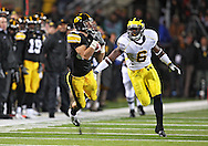 October 10, 2009: Iowa wide receiver Trey Stross (86) pulls in a pass as Michigan cornerback Donovan Warren (6) defends during the first half of the Iowa Hawkeyes' 30-28 win over the Michigan Wolverine's at Kinnick Stadium in Iowa City, Iowa on October 10, 2009.
