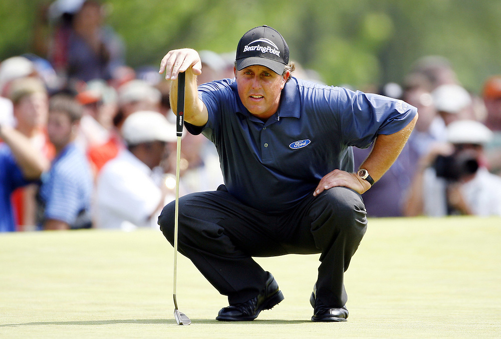 Phil Mickelson of the US lines up a putt on the fifth hole during the third day of the US Open Golf Championship at Winged Foot Golf Club in Mamaroneck, New York Saturday, 17 June 2006. .
