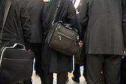 businesspeople  in black suits and briefcases