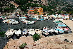 FRANCE PROVENCE CALANQUES DE MURGION 1OCT06 - Fishing boats and yachts moored in the bay of the Calanques de Murgion to the east of Marseille, set agains the imposing limestone rocks of the Provence.. . jre/Photo by Jiri Rezac. . © Jiri Rezac 2006. . Contact: +44 (0) 7050 110 417. Mobile:  +44 (0) 7801 337 683. Office:  +44 (0) 20 8968 9635. . Email:   jiri@jirirezac.com. Web:    www.jirirezac.com. . © All images Jiri Rezac 2006 - All rights reserved.