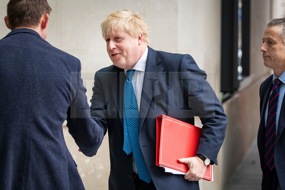 © Licensed to London News Pictures. Foreign Secretary BORIS JOHNSON (centre) arrives at BBC Broadcasting House to appear on the Andrew Marr Show. 15/04/2018. London, UK. Photo credit: Rob Pinney/LNP