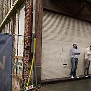 Passersby at Brussels' Molenbeek neighbourhood, a hotbed of Islamic fundamentalism.