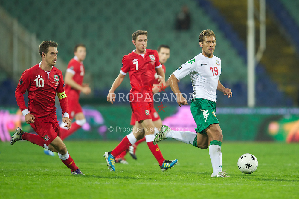 SOFIA, BULGARIA - Tuesday, October 11, 2011: Wales' captain Aaron Ramsey and Joe Allen with Bulgaria's captain Stilyan Petrov during the UEFA Euro 2012 Qualifying Group G match at the Vasil Levski National Stadium. (Pic by David Rawcliffe/Propaganda)