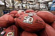 Official balls for the NFL Super Bowl 50 football game are seen in a bin prior to final inspection at the Wilson Sporting Goods Co. in Ada, Ohio, Tuesday, Jan. 26, 2016. The Denver Broncos will play the Carolina Panthers in the Super Bowl on Feb. 7 in Santa Clara, CA. (AP Photo/Rick Osentoski)