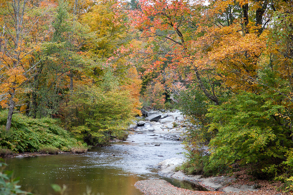 Early fall color frames Black Creek in northern Vermont, New England.